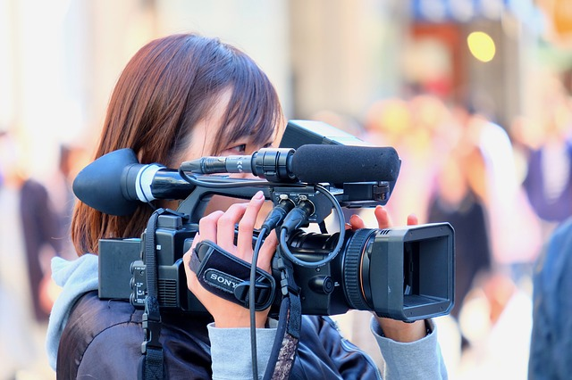 žena Kameraman